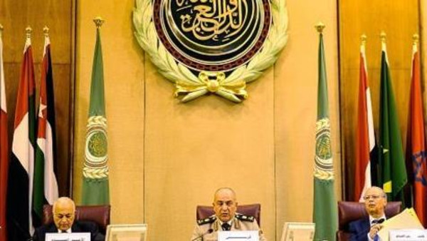 CAIRO, EGYPT - APRIL 22:  Chief of Staff of The Armed Forces Mahmoud Hegazy (C) and Secretary-General of the Arab League Nabil Elaraby (L) attend  the meeting of the army chiefs from Arab League nations at the Arab League headquarters in Cairo, on April 22, 2015. Army chiefs from Arab League nations met to start work on the establishment of a region-wide military force. (Photo by Mohamed Mahmoud/Anadolu Agency/Getty Images)