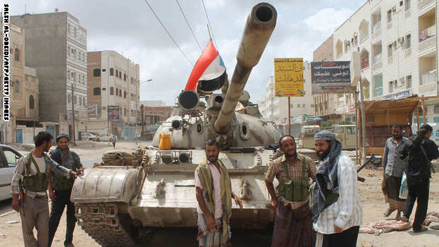 Yemeni members of the southern separatist movement, loyal to President Abedrabbo Mansour Hadi, stand next to a tank on April 15, 2015 in Aden's northern suburbs. Saudi-led coalition air strikes hit rebel targets in the Yemen's main southern city after overnight attacks by anti-government forces killed seven people, military sources and medics said. AFP PHOTO /  SALEH AL-OBEIDI        (Photo credit should read SALEH AL-OBEIDI/AFP/Getty Images)