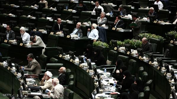 "Iranian MPs listen to the speech of Foreign Minister Mohammad Javad Zarif in the parliament in Tehran on July 21, 2015 to defend last week's Vienna accord which will see the lifting of sanctions imposed on Iran because of its nuclear programme. Zarif said that the country had achieved a ""balanced"" nuclear deal with world powers, telling lawmakers there was a need to accept the negotiations had required compromise. AFP PHOTO/BEHROUZ MEHRI        (Photo credit should read BEHROUZ MEHRI/AFP/Getty Images)"